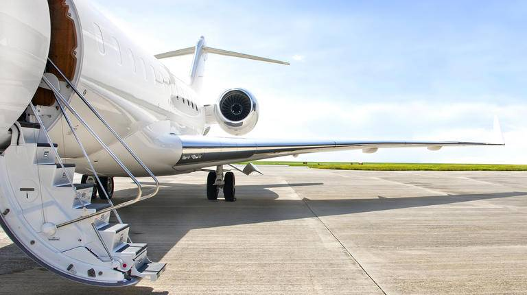 Private jet on Tarmac with door open