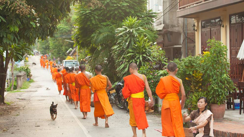 Buddhist monks gathering morning alms