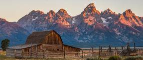 old barn with grand Tetons in background