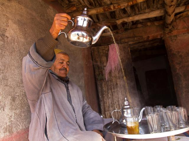 Berber man pouring tea, Atlas Mountains, Morocco