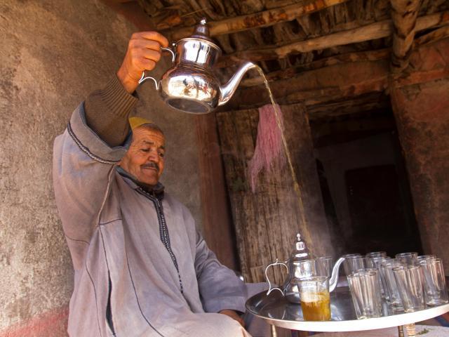 Berber man pouring tea, Atlas Mountains, Morocco